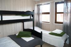Olderfjord Hotell Russenes, спальня в коттедже
