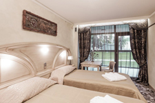 Отель Dzukija, спальня в апартах