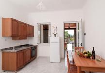Апартаменты Residence Le Vigne, кухня