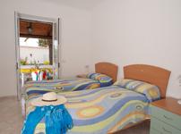 Апартаменты Residence Le Vigne, спальня